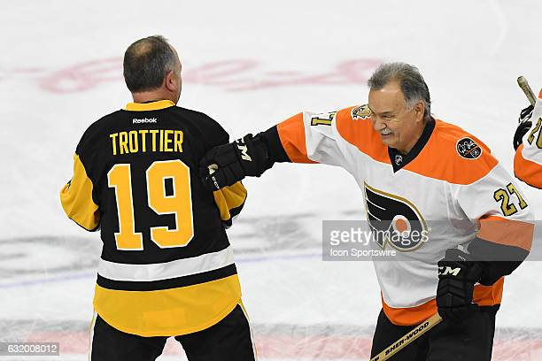 Philadelphia Flyers right wing Reggie Leach and Pittsburgh Penguins left wing Bryan Trottier fool around during a NHL hockey game between the...