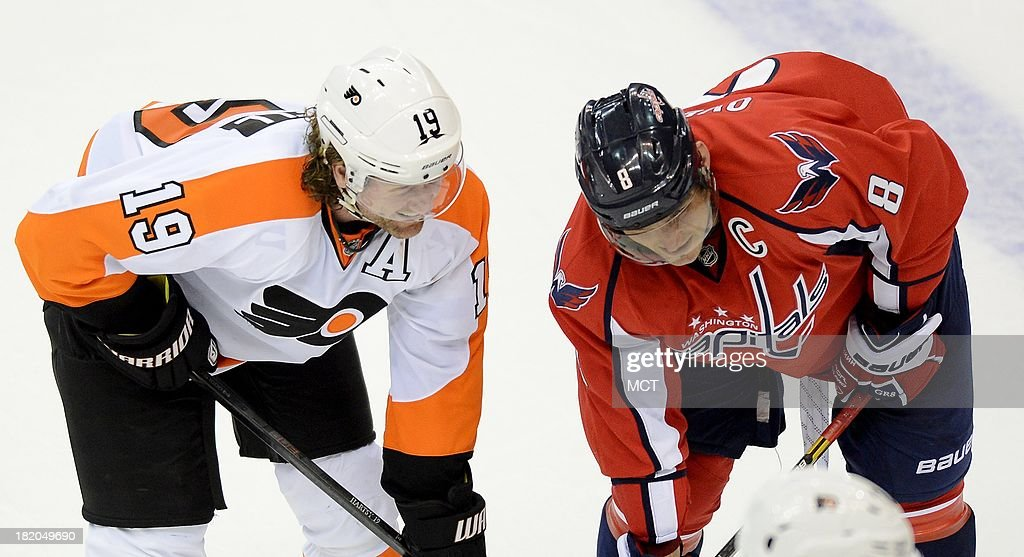 Philadelphia Flyers right wing Scott Hartnell (19) and Washington Capitals right wing Alex Ovechkin (8) chat before a face off in the third period of a preseason game at the Verizon Center in Washington, D.C., Friday, September 27, 2013. The Capitals defeated the Flyers, 6-3.