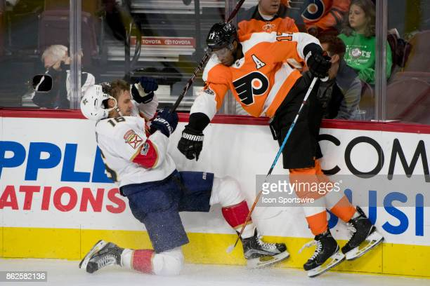 Philadelphia Flyers Right Wing Wayne Simmonds checks Florida Panthers Center Aleksander Barkov into the boards in the first period during the game...