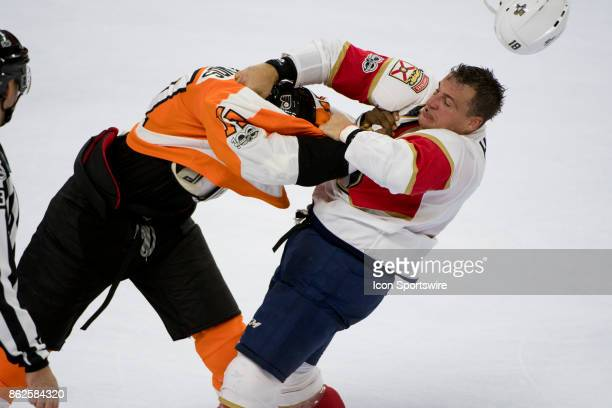 Philadelphia Flyers Right Wing Wayne Simmonds knocks the helmet off of Florida Panthers Left Wing Micheal Haley during a fight in the second period...