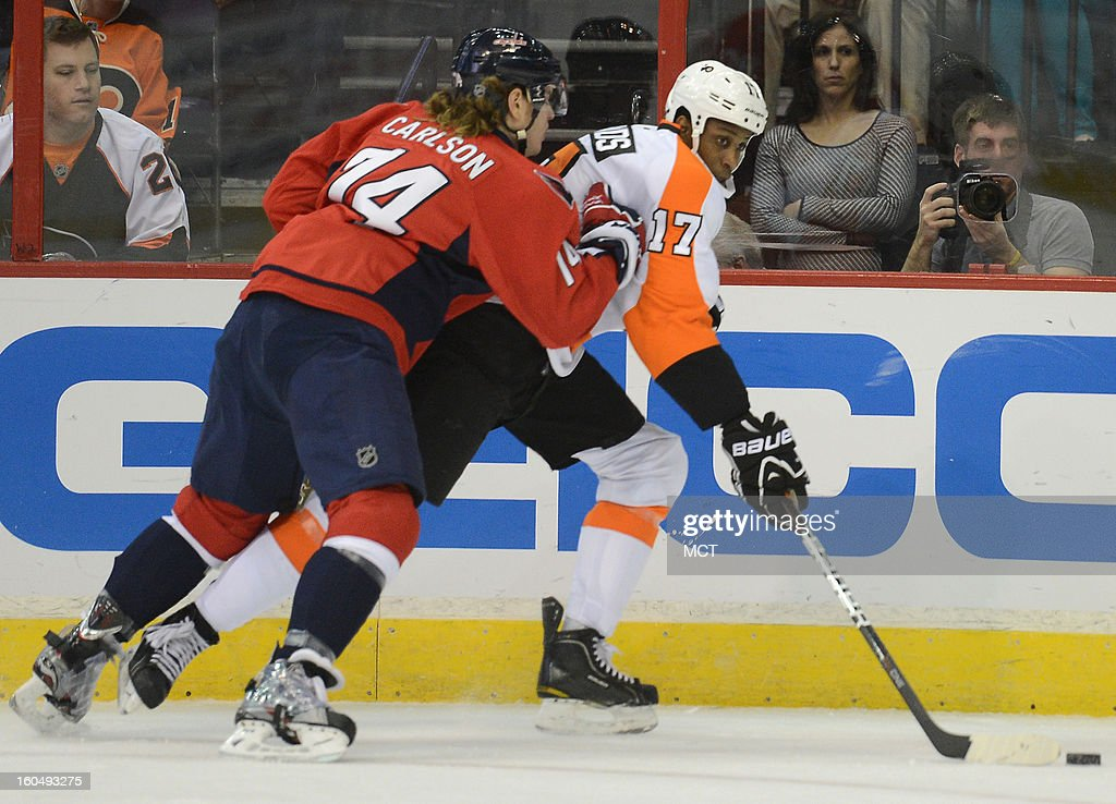 Philadelphia Flyers right wing Wayne Simmonds (17) works the puck along the boards against Washington Capitals defenseman John Carlson (74) in the first period at the Verizon Center in Washington, D.C., Friday, February 1, 2013.