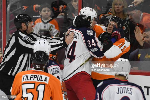 Philadelphia Flyers Winger Travis Konecny and Columbus Blue Jackets Right Wing Josh Anderson earn offsetting minors during a National Hockey League...