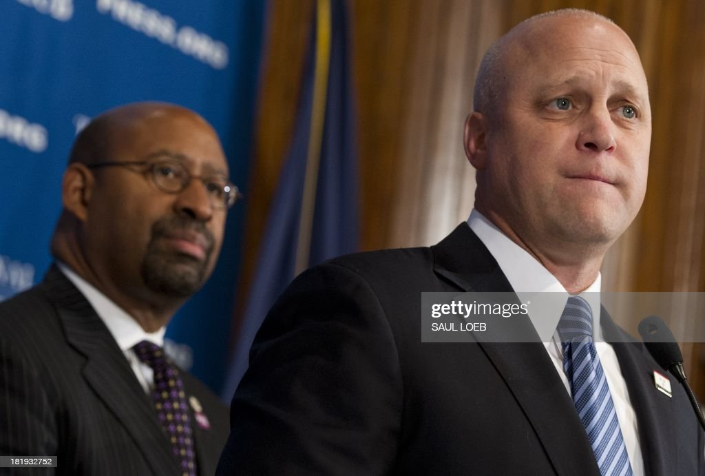 Philadelphia Mayor Michael Nutter (L) and New Orleans Mayor Mitch Landrieu (R) speak about ways to reduce US murder and gun violence rates and other issues affecting urban communities at the National Press Club in Washington, DC, September 26, 2013. AFP PHOTO / Saul LOEB
