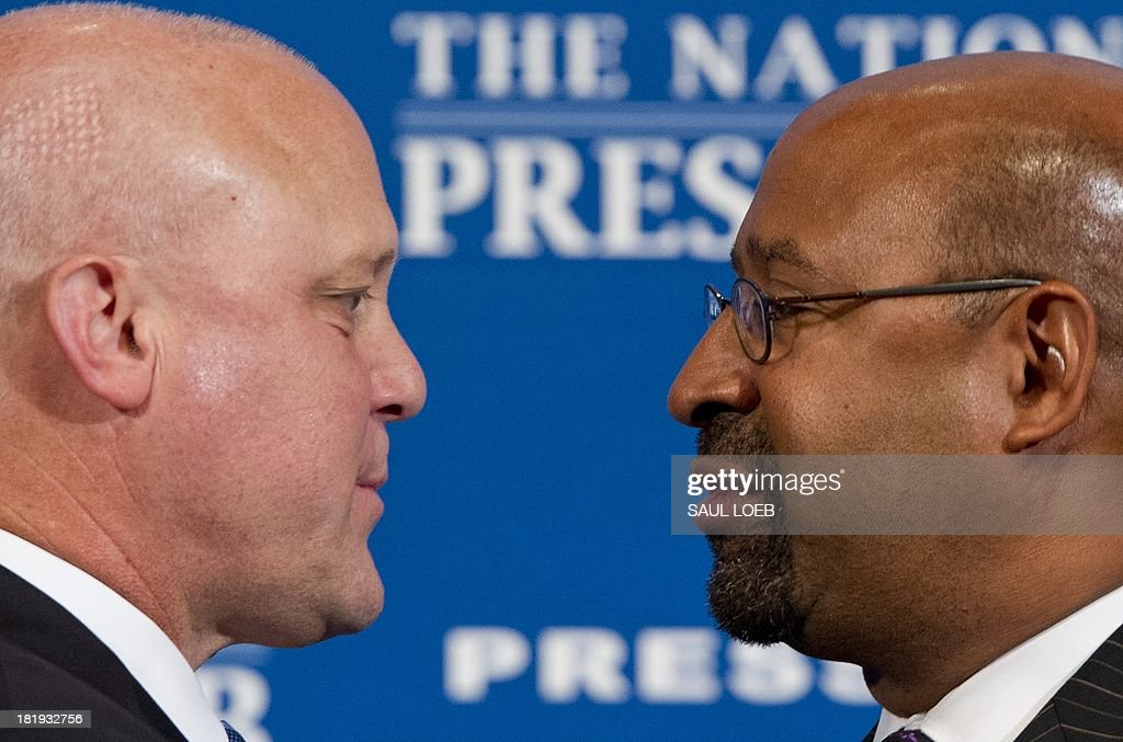 Philadelphia Mayor Michael Nutter (R) and New Orleans Mayor Mitch Landrieu (L) speak about ways to reduce US murder and gun violence rates and other issues affecting urban communities at the National Press Club in Washington, DC, September 26, 2013. AFP PHOTO / Saul LOEB