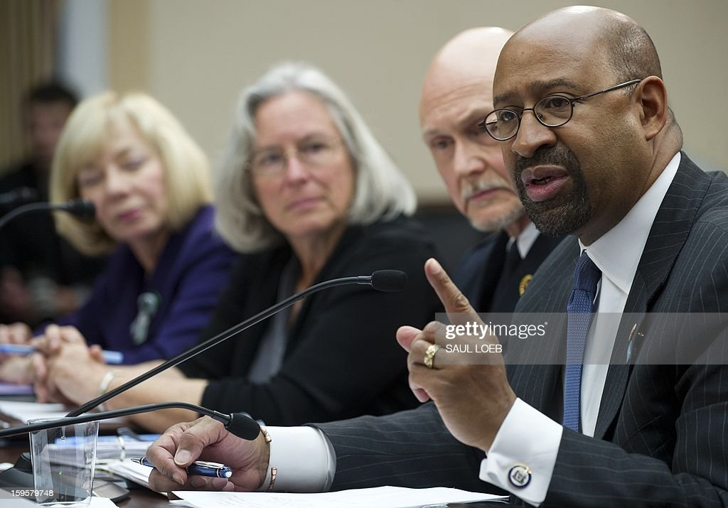 Philadelphia Mayor Michael Nutter speaks about gun violence during a meeting of the House Democratic Steering and Policy Committee on Capitol Hill in Washington, DC, on January 16, 2013. Alongside Nutter are (L-R): Newtown School Superintendent Janet Robinson, Emily Nottingham, mother of Congressional staffer Gabe Zimmerman who was killed during the mass shooting attack on former US Representative Gabrielle Giffords, and Police Chief Scott Knight of Chaska, Minnesota. AFP PHOTO / Saul LOEB