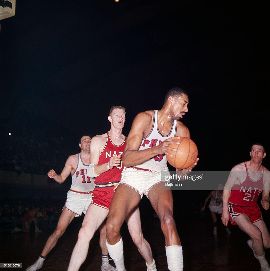 Wilt Chamberlain Holding Basketball