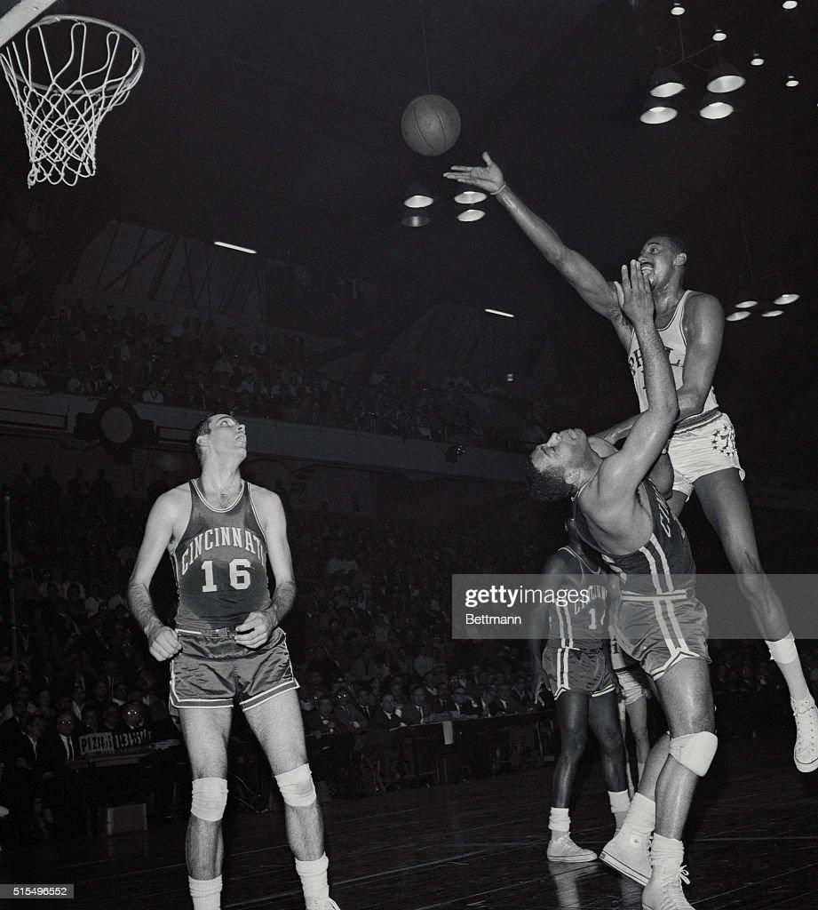Wilt Chamberlain Jumping over Wayne Embry