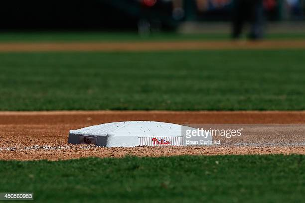 Philadelphia Phillies base sits on the baseline during the game against the Arizona Diamondbacks at Citizens Bank Park on August 25 2013 in...