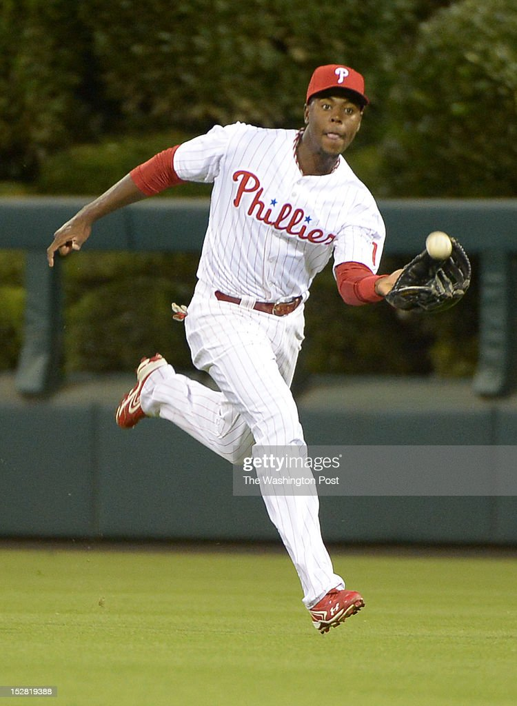 Philadelphia Phillies center fielder John Mayberry Jr. (15) tracks a fly ball by Washington Nationals shortstop Ian Desmond (20) for a 2nd inning out on Sept. 25, 2012 in Philadelphia, PA