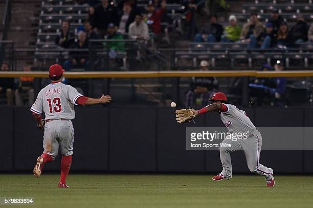 Philadelphia Phillies center fielder Odubel Herrera dives but is unable to make a catch on a ball hit by Colorado Rockies center fielder Drew Stubbs...