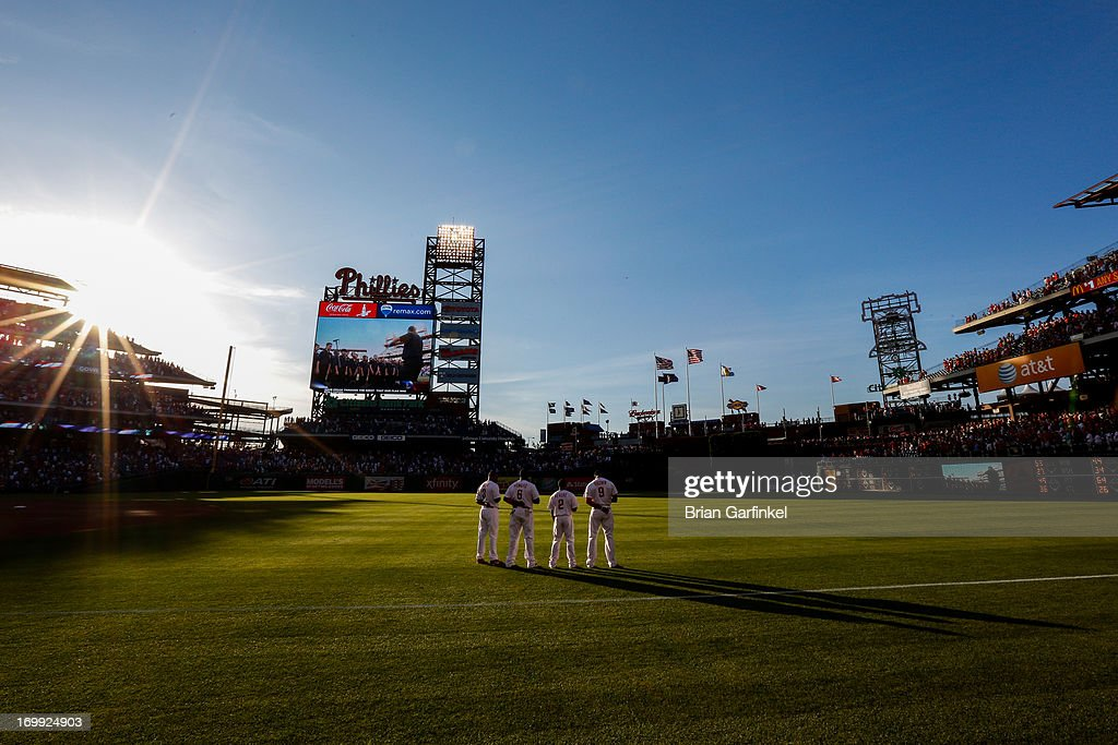 Philadelphia Phillies <a gi-track='captionPersonalityLinkClicked' href=/galleries/search?phrase=Delmon+Young&family=editorial&specificpeople=700362 ng-click='$event.stopPropagation()'>Delmon Young</a> #3, <a gi-track='captionPersonalityLinkClicked' href=/galleries/search?phrase=Ryan+Howard&family=editorial&specificpeople=551402 ng-click='$event.stopPropagation()'>Ryan Howard</a> #6, <a gi-track='captionPersonalityLinkClicked' href=/galleries/search?phrase=Ben+Revere&family=editorial&specificpeople=6826641 ng-click='$event.stopPropagation()'>Ben Revere</a> #2 and Domonic Brown #9 face the flag during the singing of the National Anthem before the game against the Miami Marlins at Citizens Bank Park on June 4, 2013 in Philadelphia, Pennsylvania.