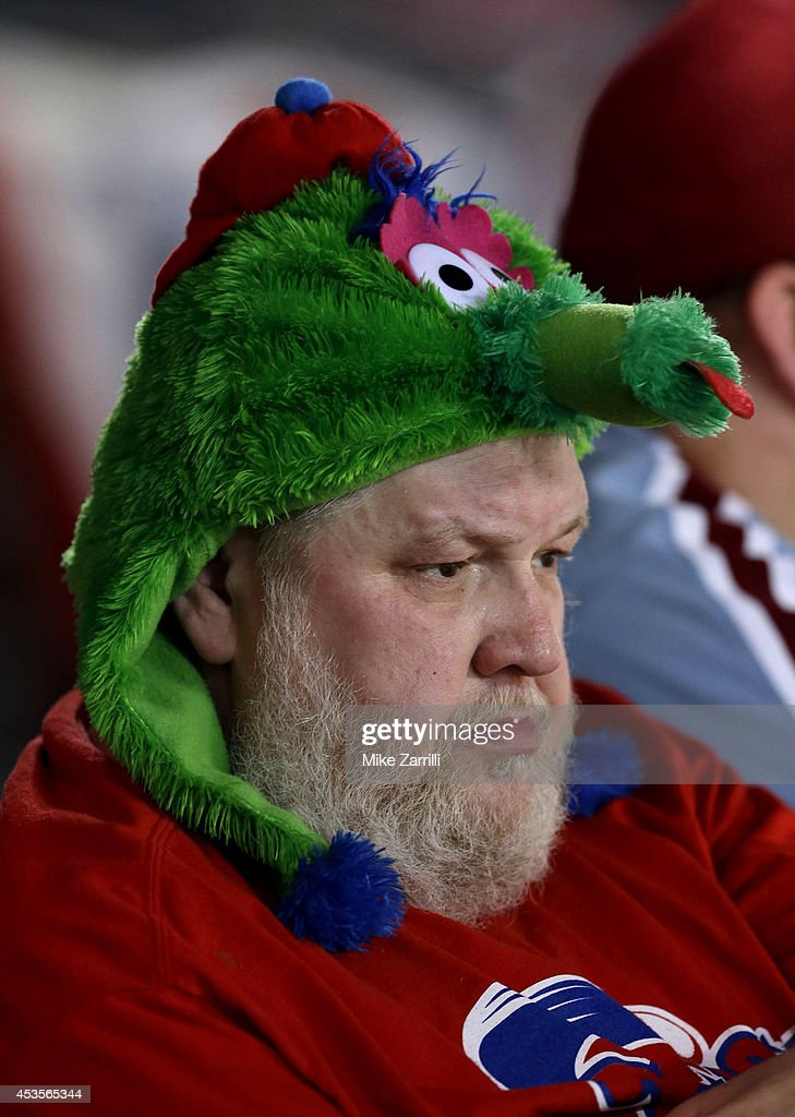A Philadelphia Phillies fan sits in the stands and is wearing a Phillie Phanatic hat during the game between the Atlanta Braves and the Philadelphia Phillies at Turner Field on June 16, 2014 in Atlanta, Georgia.