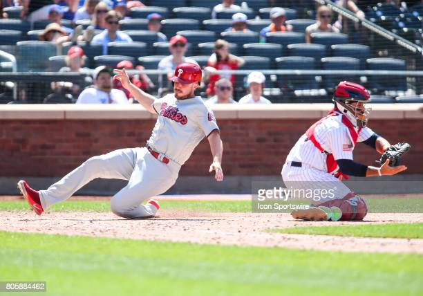 Philadelphia Phillies First Baseman Brock Stassi scores on a 2RBI single by Philadelphia Phillies Outfielder Daniel Nava during the eighth inning of...