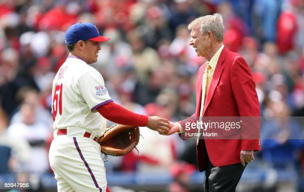 Philadelphia Phillies Hall of Fame broadcaster Harry Kalas greets catcher Carlos Ruiz after throwing out the first pitch before a game against the...