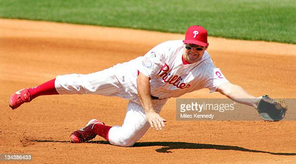 Philadelphia Phillies Jim Thome makes a diving catch on a ground ball hit by Atlanta Braves Adam LaRoche in the 4th inning Saturday July 10 2004 in...