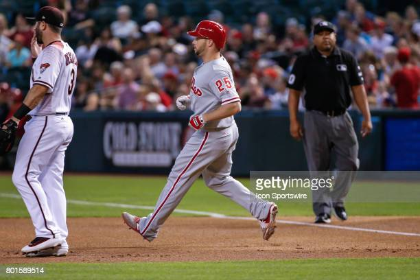 Philadelphia Phillies left fielder Daniel Nava rounds first after getting a hit during the MLB baseball game between the Philadelphia Phillies and...