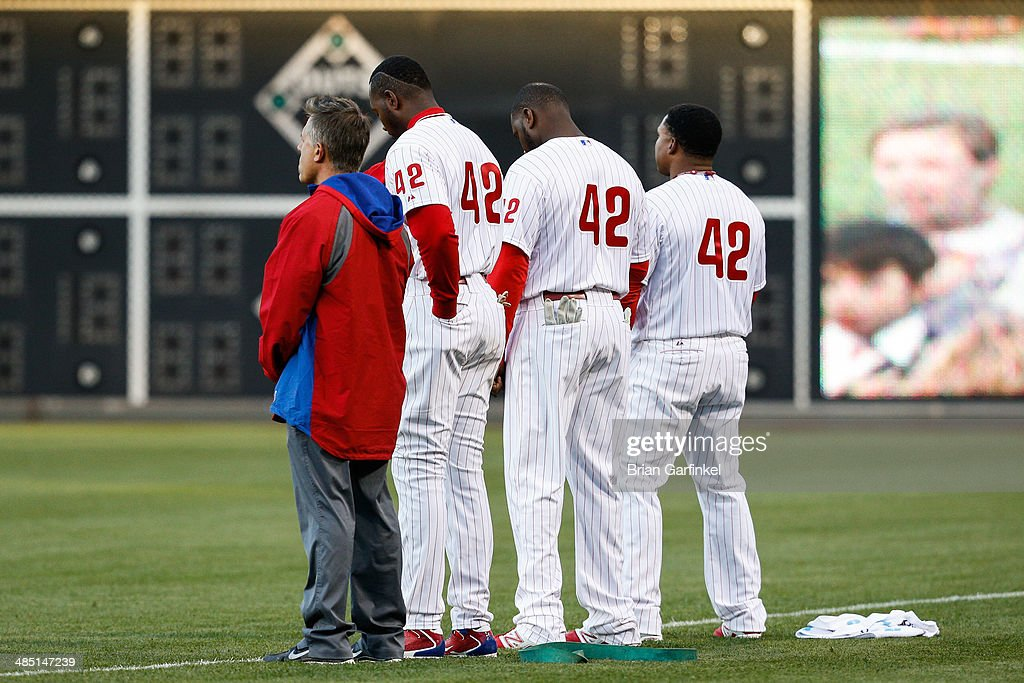 Philadelphia Phillies look on during the singing of the National Anthem before the game against the Atlanta Braves at Citizens Bank Park on April 16, 2014 in Philadelphia, Pennsylvania. All uniformed team members are wearing jersey number 42 in honor of Jackie Robinson Day.