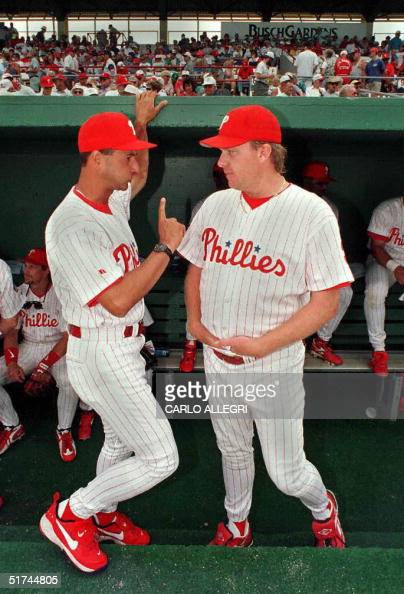 Philadelphia Phillies manager Terry Francona talks with pitcher Curt Schilling before their game against the St Louis Cardinals at Jack Russell...