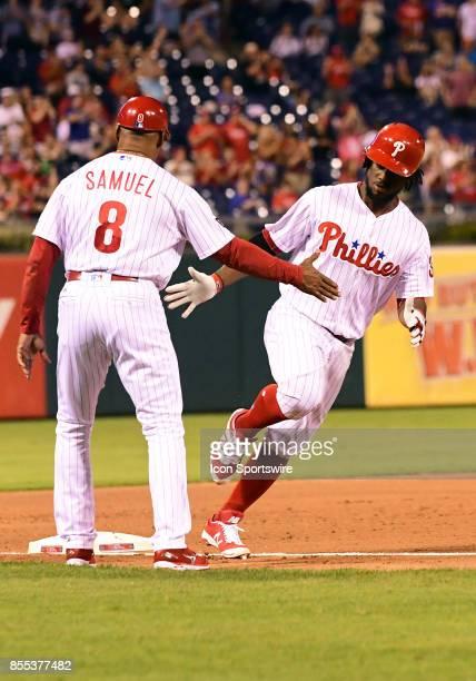 Philadelphia Phillies Outfield Odubel Herrera shakes hands with Philadelphia Phillies third base coach Juan Samuel after hitting a solo home run...
