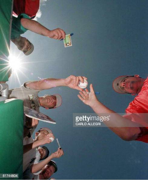 Philadelphia Phillies pitcher Ricky Bottalico signs autographs before his team's game against the St Louis Cardinals at Jack Russell Stadium in...