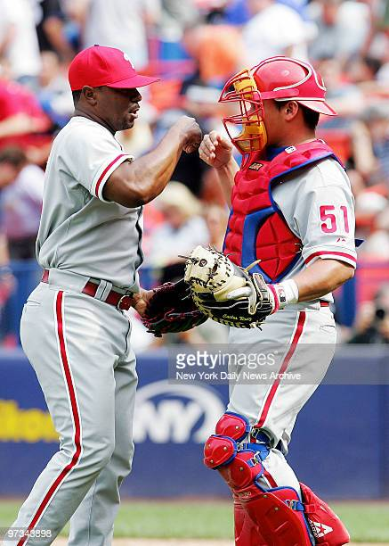 Philadelphia Phillies' pitcher Tom Gordon celebrates with catcher Carlos Ruiz after closing out a game against the New York Mets for a 53 Phillies...