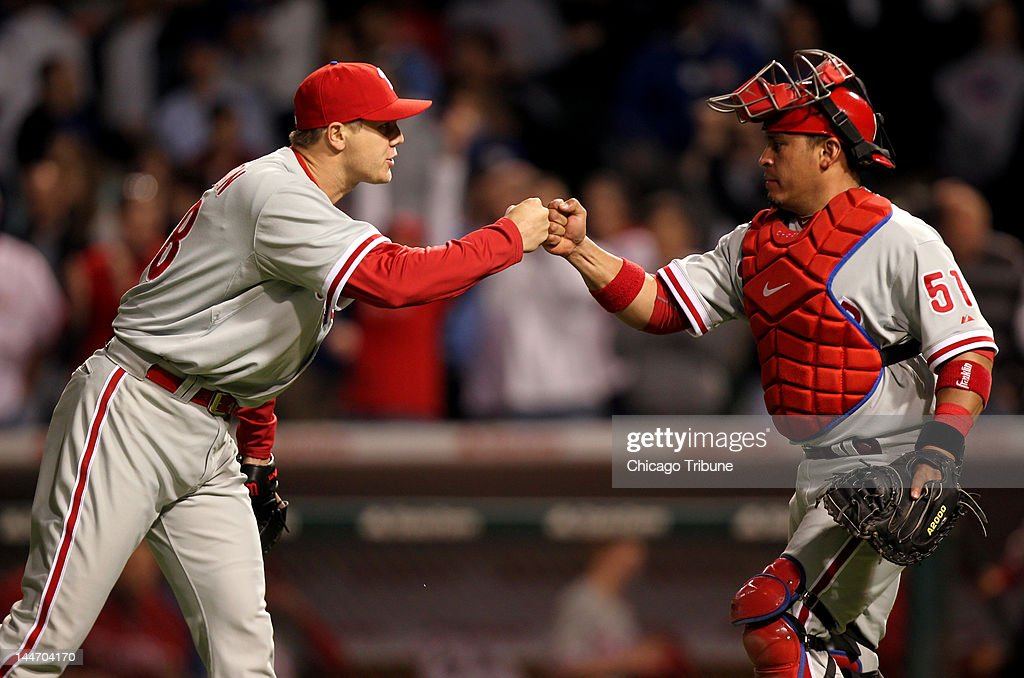 Philadelphia Phillies relief pitcher Jonathan Papelbon, left, celebrates with catcher Carlos Ruiz after closing out the Chicago Cubs in the ninth inning at Wrigley Field in Chicago, Illinois, on Thursday, May 17, 2012. The Phillies won, 8-7.