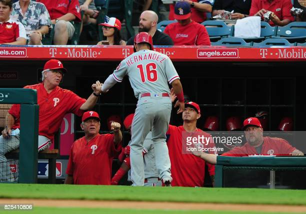 Philadelphia Phillies second baseman Cesar Hernandez is greeted in the dugout after scoring on a Tommy Joseph single in the first inning of a game...