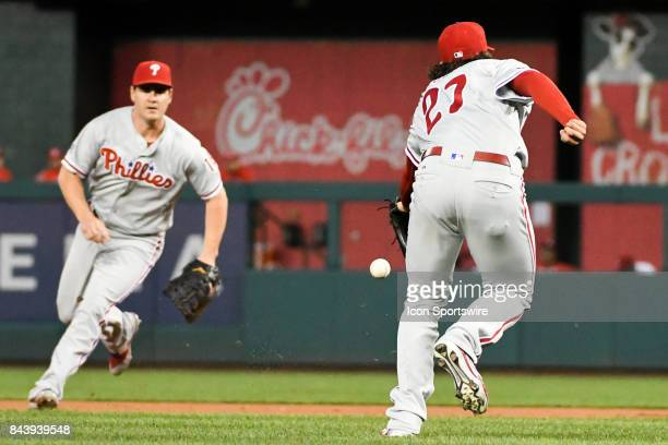 Philadelphia Phillies starting pitcher Aaron Nola cannot get to an infield single as first baseman Tommy Joseph fields the ball during an MLB game...