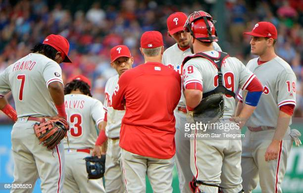 Philadelphia Phillies starting pitcher Zach Eflin gets a visit from pitching coach Bob McClure with the bases loaded and Texas Rangers third baseman...