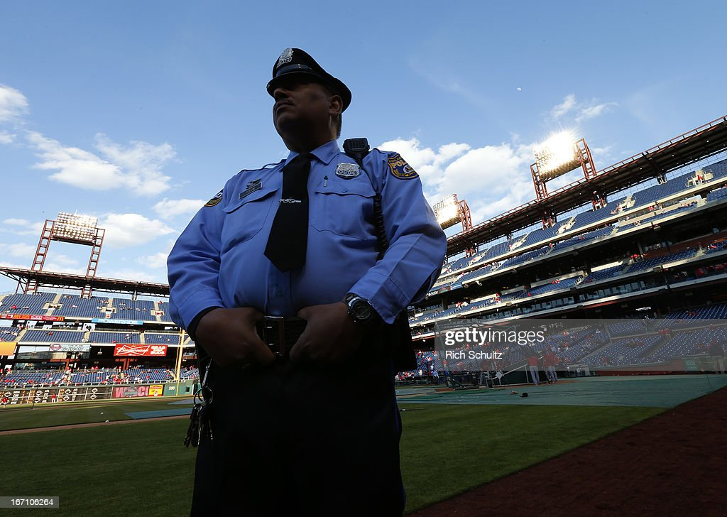 A Philadelphia police officer stands on the field before the start of a baseball game between the St. Louis Cardinals and Philadelphia Phillies on April 20, 2013 at Citizens Bank Park in Philadelphia, Pennsylvania.