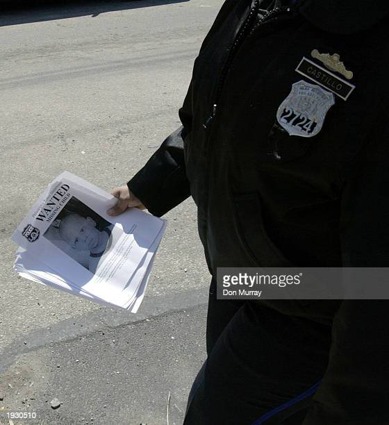 Philadelphia police officers search a North Philadelphia neighborhood passing out flyers with missing twoyearold Tyree Hand's picture on them April...