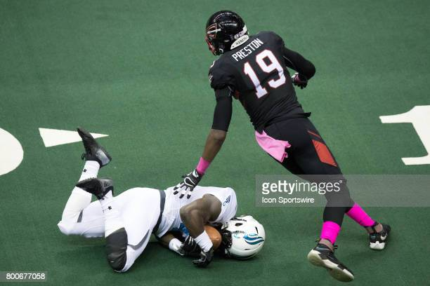 Philadelphia Soul DB Kent Richardson makes a diving interception in front of Cleveland Gladiators WR Michael Preston during the third quarter of the...