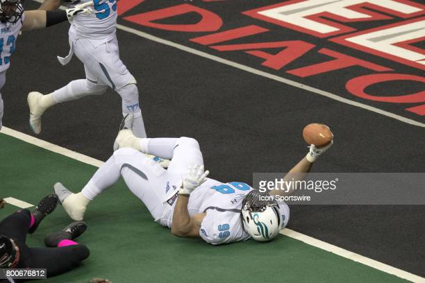 Philadelphia Soul DL Justin Lawrence reaches the football over the goal line as he scores on a 4yard fumble return during the fourth quarter of the...