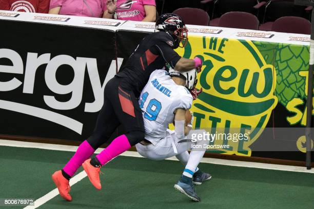 Philadelphia Soul WR Ryan McDaniel is hit by Cleveland Gladiators DB Fredrick Obi after making a catch during the third quarter of the Arena Football...