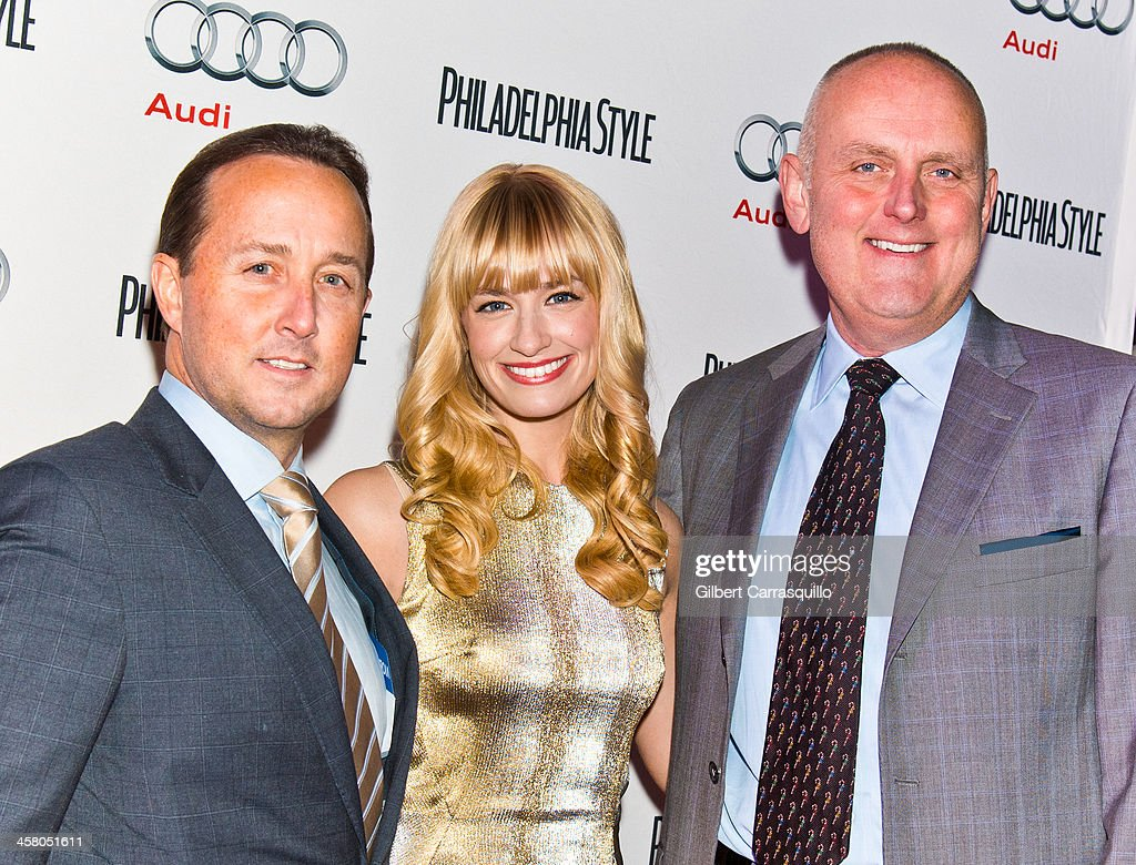 Philadelphia Style Magazine Publisher John Colabelli, actress <a gi-track='captionPersonalityLinkClicked' href=/galleries/search?phrase=Beth+Behrs&family=editorial&specificpeople=6556378 ng-click='$event.stopPropagation()'>Beth Behrs</a> and Greater Philadelphia Area General Manager at Audi of America, Michael Brairton attend the Philadelphia Style Magazine Holiday Issue Release Party at Trust on December 19, 2013 in Philadelphia, Pennsylvania.