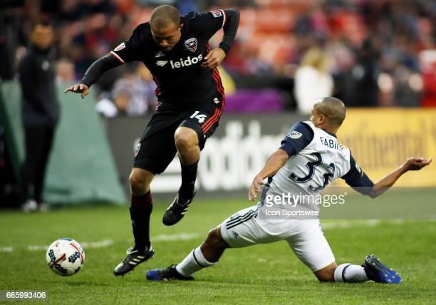 Philadelphia Union defender Fabinho challenges DC United midfielder Nick DeLeon during a match between DC United and Philadelphia Union at RFK...