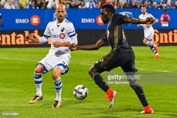 Philadelphia Union forward Jay Simpson in control of the ball trying to go around Montreal Impact defender Laurent Ciman during the Philadelphia...