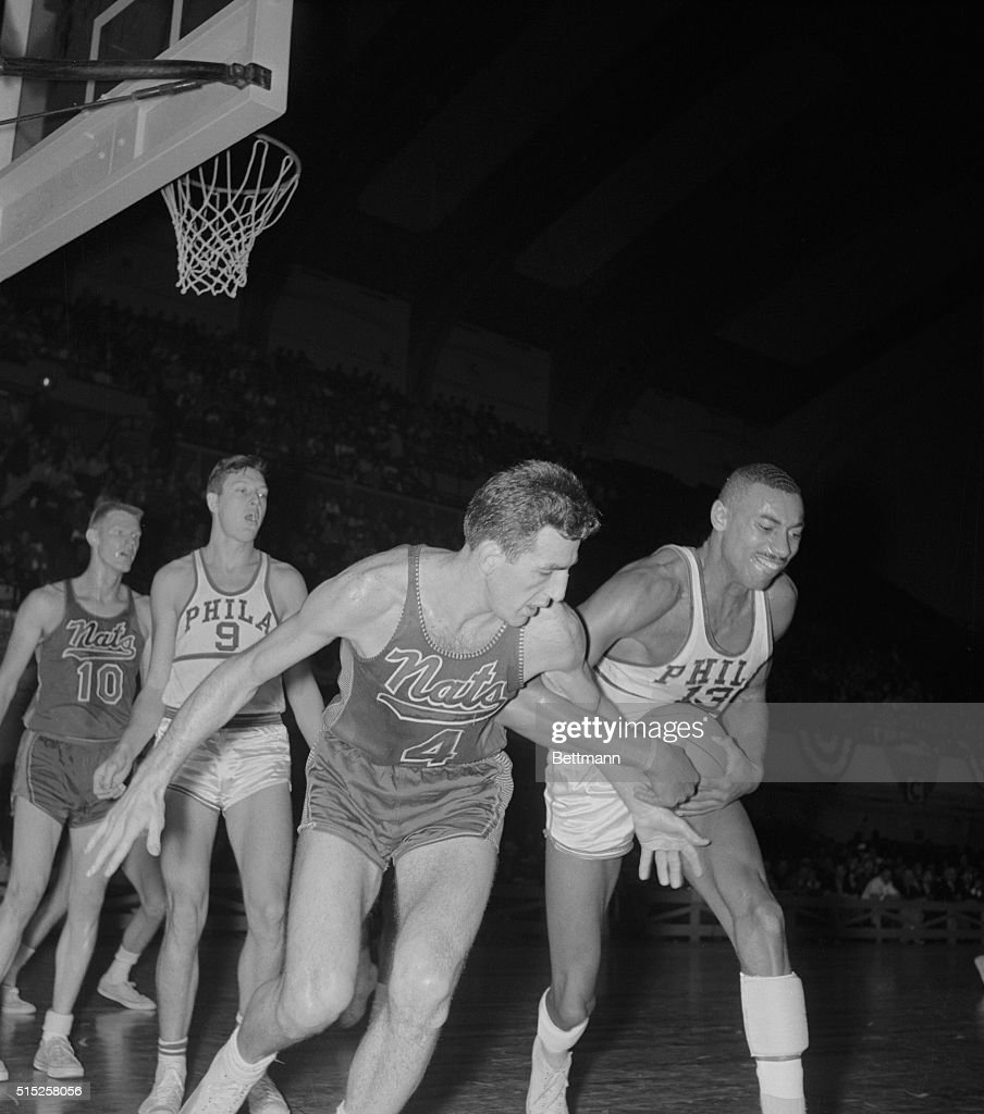 Nat Dolph Schayes and Wilt Chamberlain Fighting for Rebound