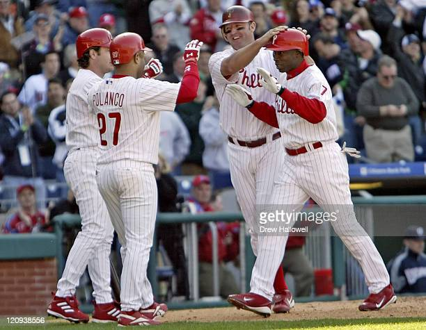 Philadelphia's David Bell Placido Polanco and Jim Thome congratulate Phillies center fielder Kenny Lofton after he hit a 3 run homerun in the fifth...