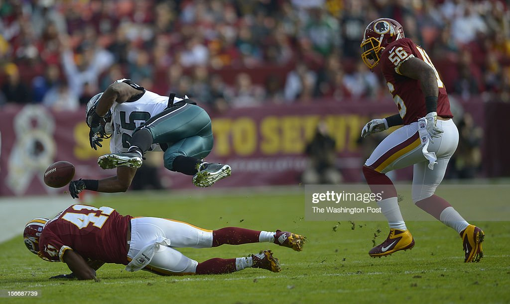 Philadelphia's running back LeSean McCoy (25) loses the ball as he is brought down by Washington's free safety Madieu Williams (41) in the first quarter as the Washington Redskins play the Philadelphia Eagles at FedEx Field in Landover MD, November 18, 2012 .