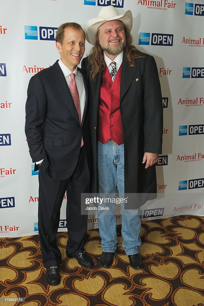 Philanthropist John Ingram and Cartoonist Guy Gilchrist attend the AnimalFair.com Bark Breakfast Benefiting K9s For Warriors at the Loews Vanderbilt Hotel on July 24, 2013 in Nashville, Tennessee.