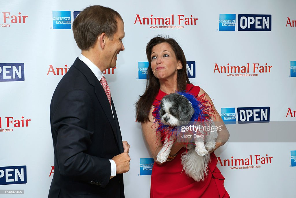 Philanthropist John Ingram and Wendy Diamond attend the AnimalFair.com Bark Breakfast Benefiting K9s For Warriors at the Loews Vanderbilt Hotel on July 24, 2013 in Nashville, Tennessee.