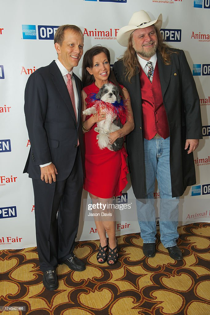 Philanthropist John Ingram, Wendy Diamond and cartoonist Guy Gilchrist attend AnimalFair.com Bark Breakfast Benefiting K9s For Warriors at the Loews Vanderbilt Hotel on July 24, 2013 in Nashville, Tennessee.