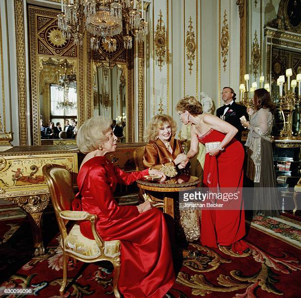 Philanthropist Marion Jorgensen writer Aileen Mehle comedian Joan Rivers in the background HSH Prince Pierre d'Arenberg and Princess Sylvie...