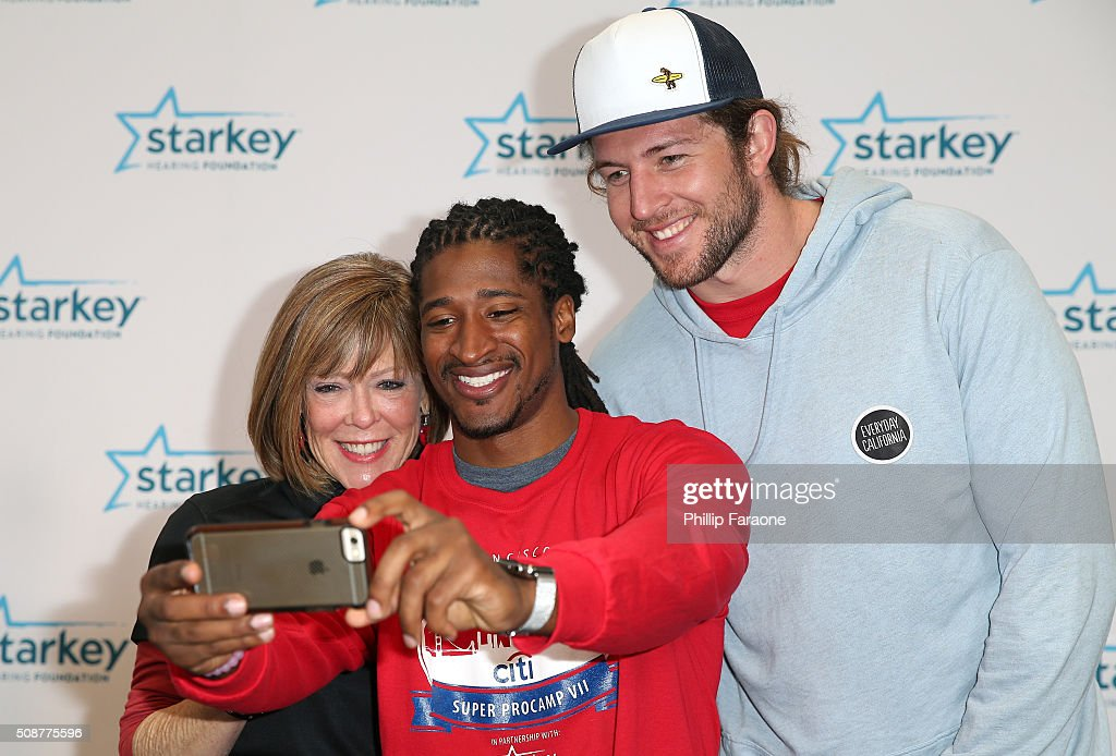 Philanthropist Sandi Young and NFL players Andre Roberts and <a gi-track='captionPersonalityLinkClicked' href=/galleries/search?phrase=Zach+Sudfeld&family=editorial&specificpeople=9688780 ng-click='$event.stopPropagation()'>Zach Sudfeld</a> pose for a selfie photo during the Starkey Hearing Foundation hearing mission during Super Bowl weekend 2016 at San Francisco State University on February 6, 2016 in San Francisco, California.