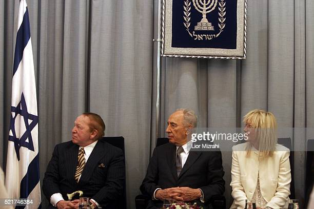 Philanthropist Sheldon Adelson Israeli President Shimon Peres and Miriam Adelson are seen during a ceremony in The President house on August 12 2007...
