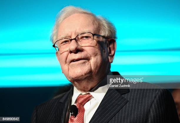 Philanthropist Warren Buffett is joined onstage by 24 other philanthropist and influential business people featured on the Forbes list of 100...