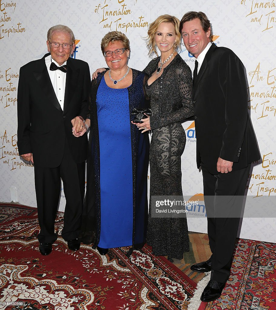 Philanthropists Alfred E. Mann and Claude Mann, Janet Jones and her husband former NHL player Wayne Gretzky attend the 10th Annual Alfred Mann Foundation Gala in the Robinsons-May Lot on October 13, 2013 in Beverly Hills, California.