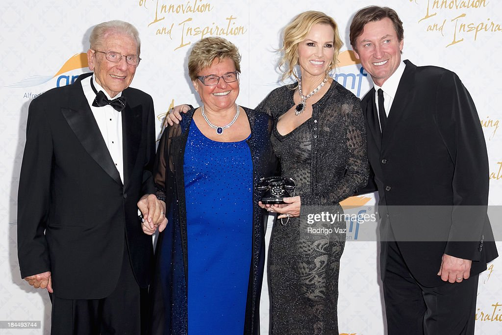 Philantropists Alfred E. Mann and Claude Mann, Janet Jones and hockey player Wayne Gretzky attend the 10th Annual Alfred Mann Foundation Gala on October 13, 2013 in Beverly Hills, California.