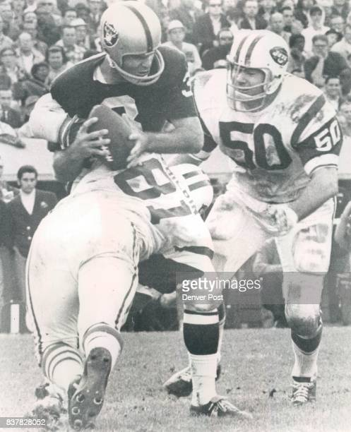 Philbin Gerry 5p New York's Gerry Philbin Here he unloads an Oakland quarterback Daryle Lamonica Credit The Denver Post